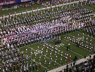 Halftime show - A group of high school marching bands performs at the halftime show of the 2006 Chick-fil-A Bowl.