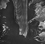 McCarty Glacier, terminus of tidewater glacier, banded ogives, hanging and mountain glaciers with icefall, August 27, 1963 (GLACIERS 6618).jpg