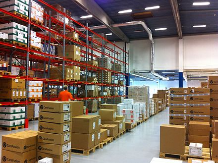 Tangible goods stacked in a warehouse Mediq Sverige Kungsbacka warehouse.jpg