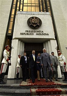 Moldovan President Vladimir Voronin escorts Secretary Rumsfeld to his car after their meeting.jpg
