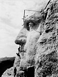 Construction on the George Washington portrait at Mount Rushmore, c. 1932.