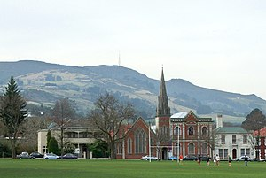 Mount Cargill - Mount Cargill (centre) and Buttar's Peak (to the right of the church steeple) dominate the skyline of Dunedin, New Zealand