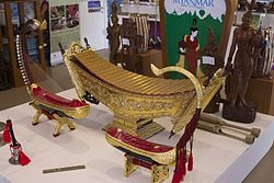 Musical instruments of Myanmar - Hne (oboe), Palwei (flute), Saung (harp), Patala (xylophone), Wa letkhoke (bamboo clappers), statues, Chauklon pat (six drums) ? - EXPO 2015 8686 (2015-07-13 12.08.49 by Luca Nebuloni).jpg