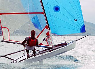 Dinghy sailing - A Musto Performance Skiff dinghy on the reach