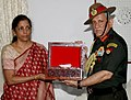Nirmala Sitharaman handing over the urn containing the sacred soil of two soldiers of 39 Garhwal Rifles from their resting place at Laventie, France to the Chief of Army Staff, General Bipin Rawat, in New Delhi.jpg