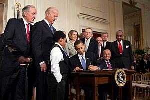 Barack Obama signing the Patient Prot...