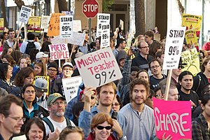 "We are the 99% - Occupy protesters in Oakland holding ""We are the 99%""-themed signs"
