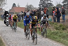 Lampaert leading Gilbert, Sagan with van Aert, Vanmarcke and Politt closely following at the Mons-en-Pévèle pavé sector