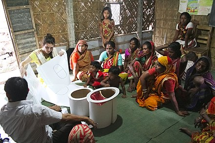 Residents in Mymensingh, Bangladesh participate in a workshop to discover more about mobile sanitation options (MoSan) as an alternative to open defecation