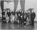 Photograph of movie stars posing with President Truman and his family at the White House, (front row, left to right)... - NARA - 199343.tif
