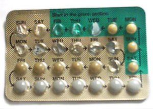 Menstruation - Half-used blister pack of a combined oral contraceptive. The white pills are placebos, mainly for the purpose of reminding the woman to continue taking the pills.