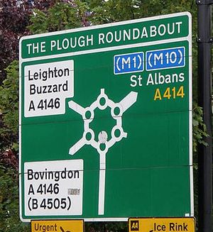 Magic Roundabout (Hemel Hempstead) - Road sign showing the official name Plough Roundabout