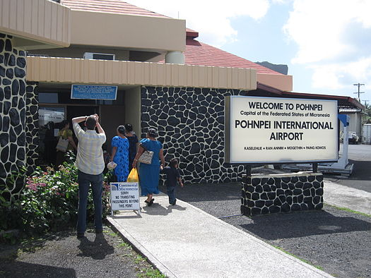 Signage for travelers at Pohnpei International Airport in official English and in Japanese (upper left).