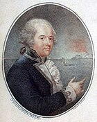 Oval portrait of a man, facing right, wearing a wig, a coat with embroidered cuffs and a frilled shirt. In the background is a sea scene with a small boat and a rocky headland.