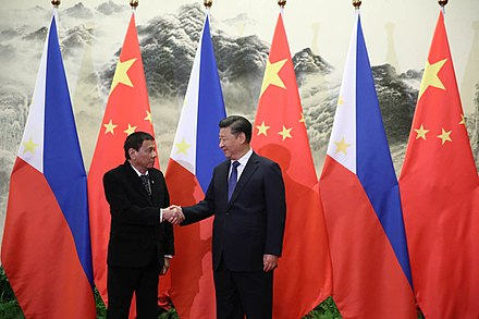 Duterte's handshake with Chinese President Xi Jinping prior to the bilateral meetings at the Great Hall of the People in Beijing, October 20, 2016 President Duterte handshake with President Xi.jpg
