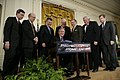 President George W. Bush is joined by House and Senate representatives as he signs H.R. 3199, USA Patriot Improvement and Reauthorization Act of 2005.jpg