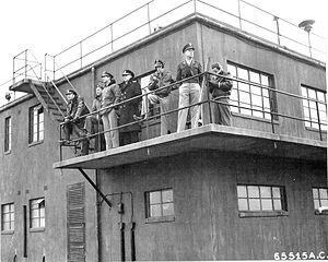 RAF Deenethorpe - RAF Deenethorpe Control Tower, waiting for the return of a mission, 26 February 1945