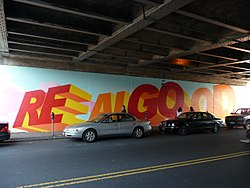 "Mural on 63rd Drive at the LIRR overpass. The words ""Real Good"" are painted onto the mural."