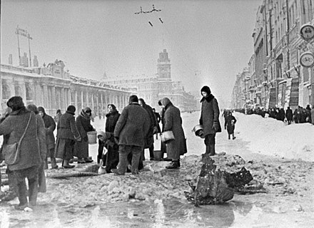 People gathering water from shell-holes on Nevsky Prospect, between Gostiny Dvor and Ostrovsky Square RIAN archive 907 Leningradians queueing up for water.jpg