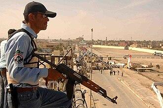 Zastava M70 - Image: Ramadi police officer with Zastava M70, 2008
