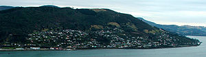 Ravensbourne, New Zealand - Ravensbourne and Maia are shown in this view from Shiel Hill on the southern side of Otago Harbour. One of the railway causeways at Burkes is visible at the far right. The television transmitter on the top of Mount Cargill is visible behind Signal Hill in the background.