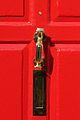Red Door In Chobham Village Surrey UK.jpg
