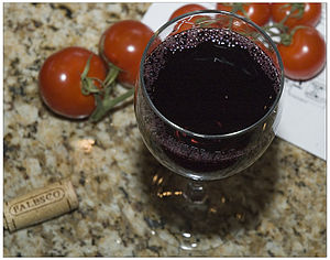 Unidentified glass of dark red wine.