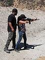 Rene helping Perla with the AR-15.jpg
