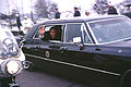 Richard Nixon waves in presidential limousine.jpg