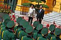 Rodrigo Duterte and Vietnamese President Tran Dai Quang stand on the dais during a ceremony at the State Palace in Hanoi on September 29.jpg