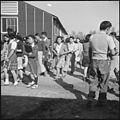 Rohwer Relocation Center, McGehee, Arkansas. Changing classes at the temporary high school quarters. - NARA - 538925.jpg