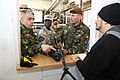 Romanian Land Forces Maj. MihaI Irminia, left, and Cpl. Ilie Zamfir, second from right, are briefed by U.S. Army Sgt. 1st Class Petanki Ouattara, center left, assigned to the Joint Multinational Readiness Center 130305-A-ZD093-004.jpg