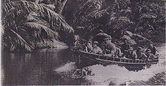 Operation Claret - Royal Marines Commando unit patrolling on the river Serudong, Sabah