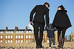 Royal Navy RNSPT and his wife and child walking on Portsmouth Beach MOD 45164759.jpg