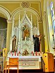 Saint Mary Catholic Church (Philothea, Ohio) - interior, altar of Saint Joseph with Saints Therese of Lisieux and Gaspar del Bufalo.jpg