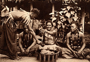 Polynesians - Kava ('ava) makers (aumaga) of Samoa. A woman seated between two men with the round tanoa (or laulau) wooden bowl in front. Standing is a third man, distributor of the 'ava, holding the coconut shell cup (tauau) used for distributing the beverage.