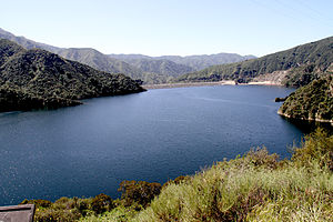San Gabriel Dam - View of a nearly full reservoir in 2011 from the north, with the dam and spillway in the background