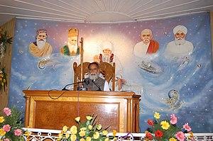 Kanwar Saheb - Kanwar Saheb giving Satsang at Bhiwani Ashram. Picture also depicts previous five gurus of Radha Swami Satsang, Dinod