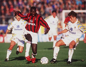 George Weah - Pictured with A.C. Milan during the 1995–96 season, Weah taking on Parma defenders outside the penalty area