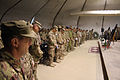 Service members from multiple nations observe a moment of prayer during a U.S. Memorial Day ceremony May 27, 2013, at Kabul International Airport in Kabul, Afghanistan 130527-A-VC572-412.jpg