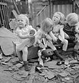 Seven Pairs of Tiny Boots- American Aid To British Children, England, 1941 D3728.jpg