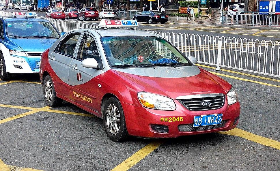 Shenzhen KIA red taxi 2