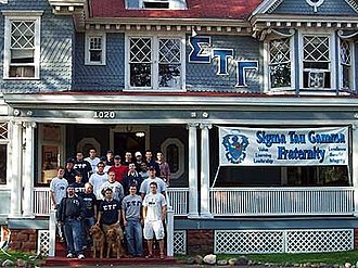 Sigma Tau Gamma - Brothers of the Gamma Chi chapter at Michigan Technological University stand in front of their Chapter House.