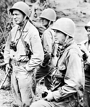 Simon Bolivar Buckner Jr. - Buckner (foreground, holding camera), photographed with Major General Lemuel C. Shepherd Jr., USMC, on Okinawa.