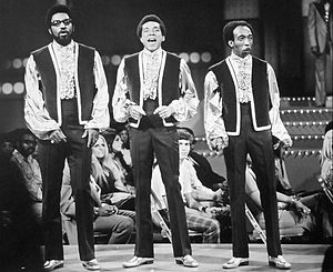 The Miracles - The Miracles performing on The Smokey Robinson Show, a 1970 ABC Television special. (L-to-R) Bobby Rogers, Smokey Robinson, Ronnie White.(Pete Moore was sidelined with a leg injury)