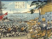 Soldiers landing on the shore from a ship and regrouping at the bottom of a wall.
