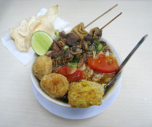Soto (food) - Soto Bangkong from Semarang, chicken soto with cockles and tripes satay, fried tempeh and perkedel
