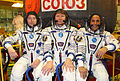 Soyuz TMA-04M crew in front of the capsule.jpg