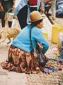 Squatting woman from Peru.jpg