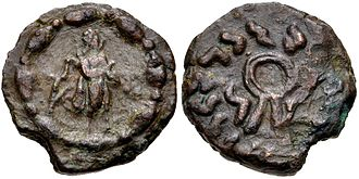 "Strato II - Monolingual coin of Strato II Soter in Prakrit only. Obv. Apollo standing right, with quiver on back, holding arrow; thick bead-and-reel border. Obv. Diadem with Kharoshthi legend ""Maharajasa tratarasa Stratasa"" (Saviour King Strato)."
